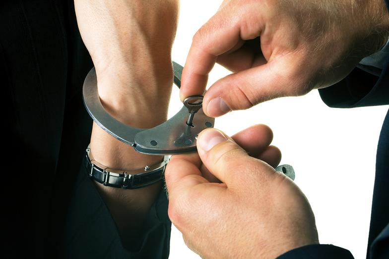 hand in a wristband and another person opening it