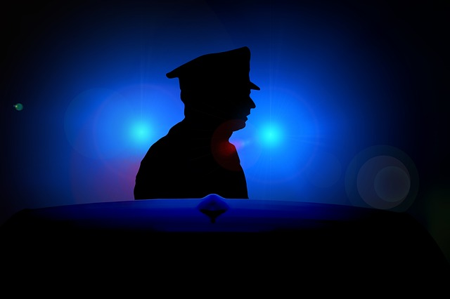 Man's silhouette on blue light police background